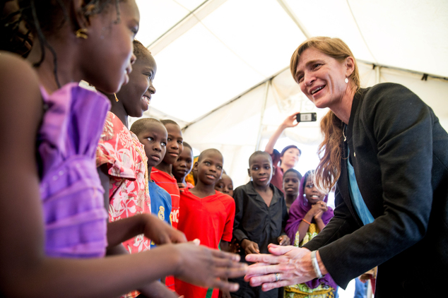 Refugee children meet with U.S. Ambassador to the United Nations Samantha Power as she visits Minawao Refugee Camp in northern Cameroon, Monday, April 18, 2016.