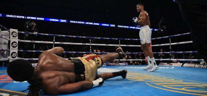 Anthony Joshua (right) knocks down Charles Martin during the IBF Heavyweight World Championship title bout at the 02 Arena, London. PRESS ASSOCIATION Photo. Picture date: Saturday April 9, 2016. See PA story BOXING London. PRESS ASSOCIATION Photo. Picture date: Saturday April 9, 2016. See PA story BOXING London. Photo credit should read: Nick Potts/PA Wire