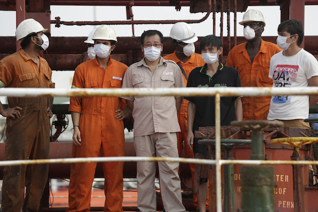 Some of the rescued crew members of the hijacked Panama-flagged Maximus vessel stand for the media in Lagos, Nigeria Monday, Feb. 22, 2016.