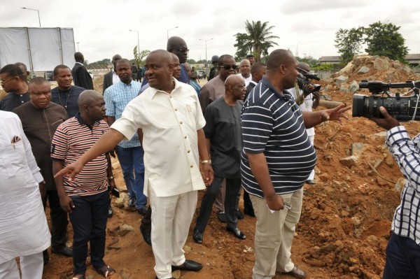 Wike in cream safari suit at a project site toady