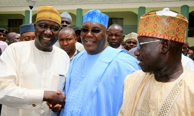 Mal Musa Garba (L) and Chief of Staff to the governor of Adamawa State, Alhaji Abdurrahman Abba, with Atiku at the event