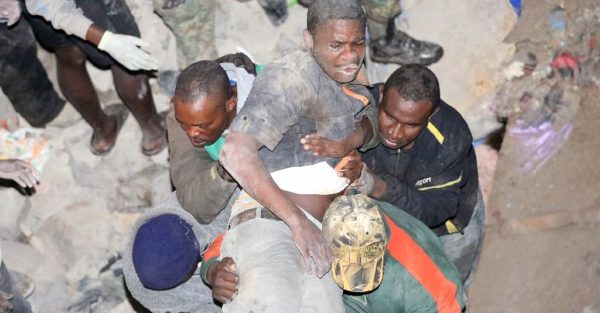 a man being pulled out of the collapsed building