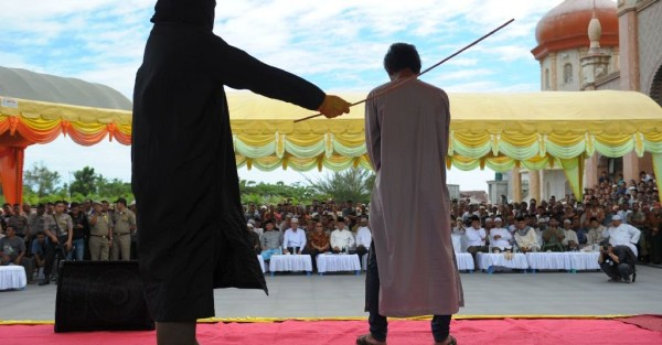 an offender being caned in Aceh Indonesia