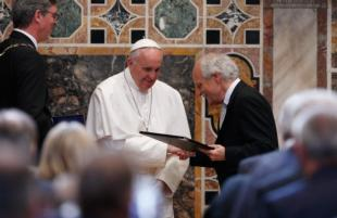 Pope Francis receives the Charlemagne Prize from Jurgen Linden, president of the Society for the Conferral of the Charlemagne Prize, during a ceremony in the Sala Regia at the Vatican May 6. At left is Marcel Philipp, mayor of Aachen, Germany, where the prize is normally presented. Vatican News Photo