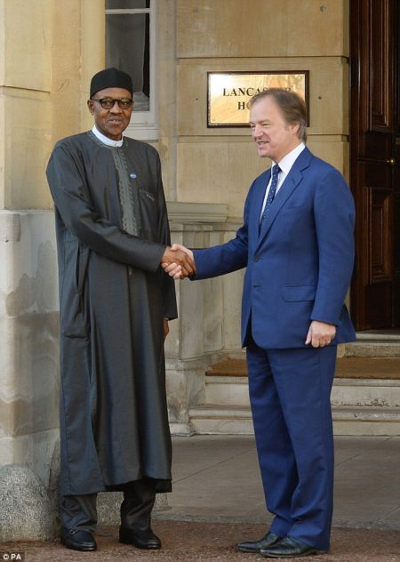 Buhari arrives at Lancaster House, recieved by Foreign Office minister Hugo Swire