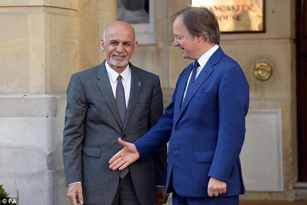 Ashraf Ghani being welcomed to Lancaster House by Foreign Office minister Hugo Swire