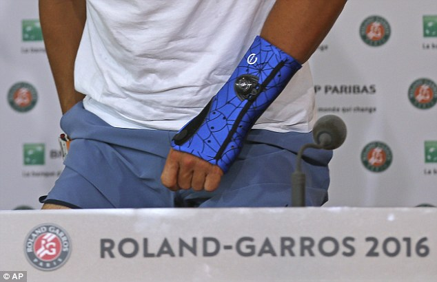 Nadal showing the blue cast on his hand