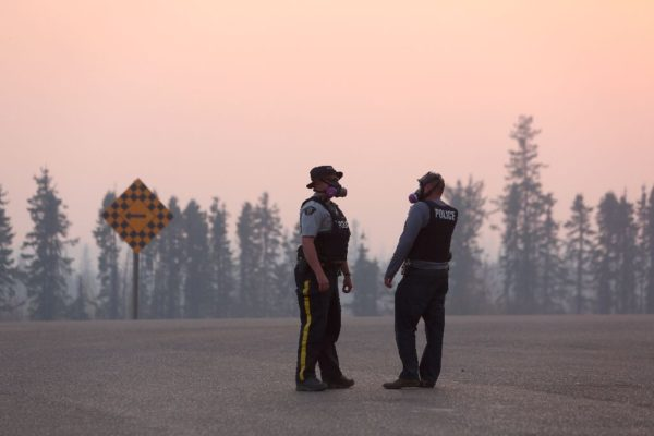 Canadian policemen monitoring the fire
