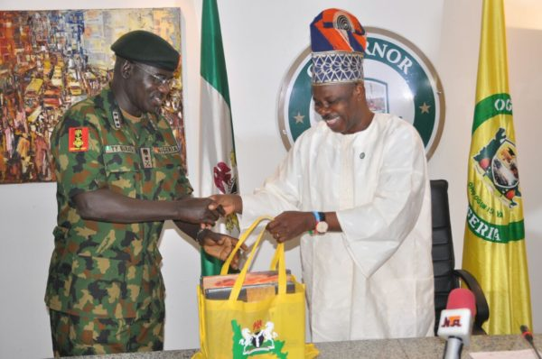Pix 1: Ogun State Governor, Senator Ibikunle Amosun, presenting a gift item to the Chief of Army Staff, Lt. General Tukur Yusuf Buratai, during a courtesy call on the governor at his Oke-Mosan, Abeokuta office on Thursday