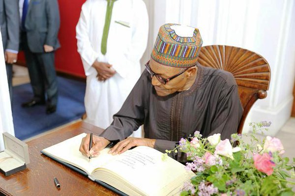 Time to say goodbye: Buhari signs the visitor's register at Archbishop Welby's place