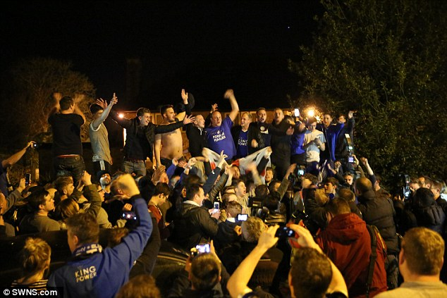 Magic night: a crowd of celebrants outside Jamie Vardy's home in Leicester
