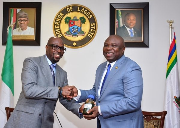 Governor Ambode (right), receiving a sample of the Crude Oil discovered in the state by the Group Managing Director, Yinka Folawiyo Petroleum Company Limited, Mr. Tunde Folawiyo during a courtesy visit to the Governor, at the Lagos House, Ikeja on Monday, May 16, 2016.