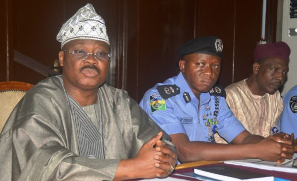 From left, Governor Abiola Ajimobi, State Commissioner of Police,  Mr. Leye Oyebade, centre and others at the peace meeting