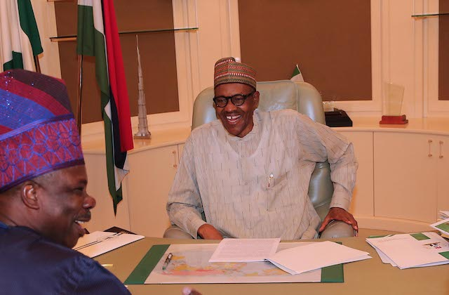 Buhari in  a rare moment of letting down his guard: enjoys a hearty laugh with Amosun
