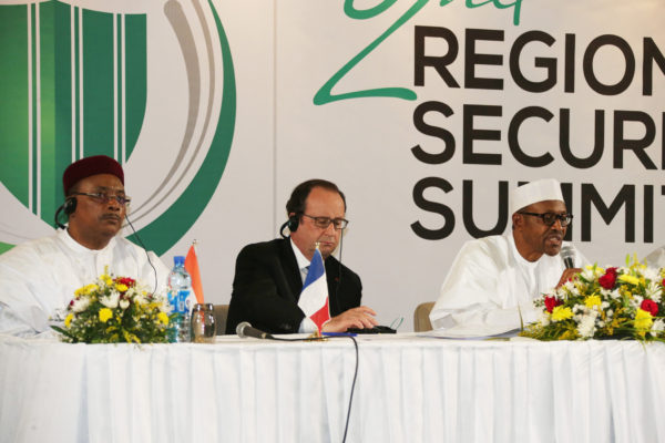 L-R; President of Chad, Mahamadou Issoufou, President of France, Mr Francios Hollande and President of Nigeria, Muhammadu Buhari during a press brIefing after the regional security Summit at the Transcorp Hilton Abuja. PHOTO; SUNDAY AGHAEZE.