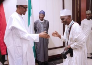President Buhari hosts State House Press Corps to a Lunch. He-greets the oldest member-of the Corps, Ladan-Abubakar.