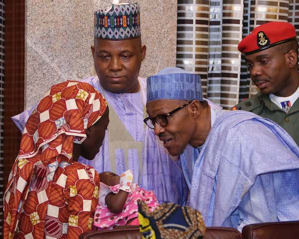 Buhari, with Gov. Shettima, greets Amina Ali and her four month old baby