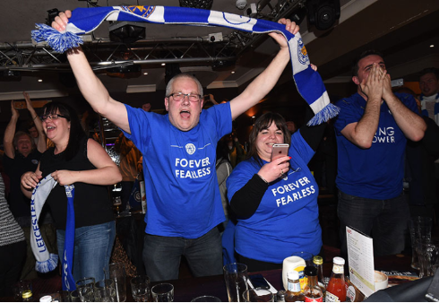 Leicester fans celebrate on Monday night