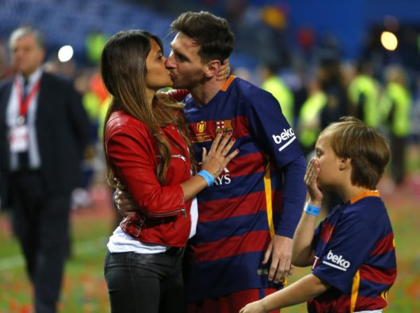 Barcelona's Lionel Messi kisses his wife Antonella Roccuzzo as they celebrate after winning the final of the Copa del Rey. AP Photo