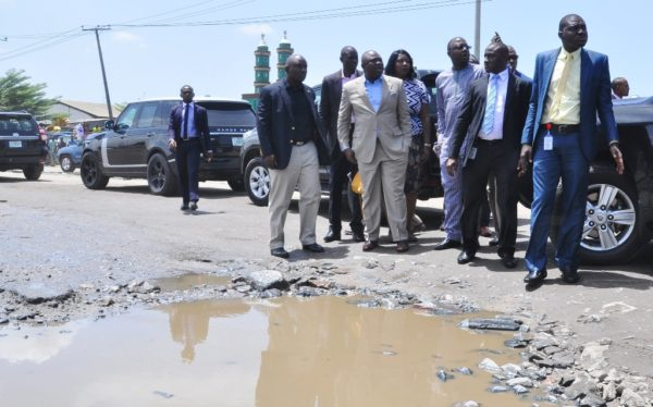 Ambode, second left, inspecting the road