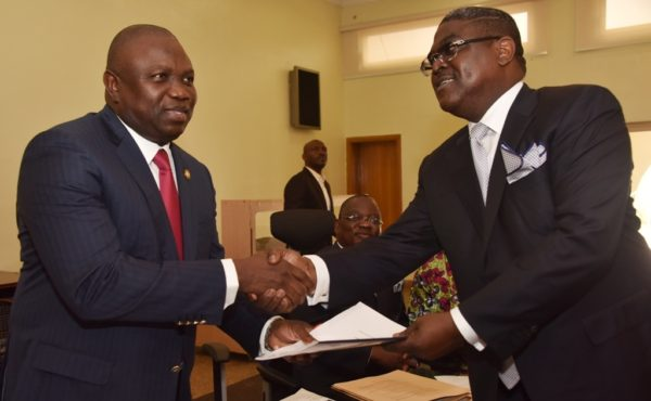 Governor Ambode (left), receiving the Memorandum of Understanding (MoU) for the 4th Mainland Bridge shortly after being signed from Executive Chairman, Visible Assets Limited, Mr. Idowu Iluyomade while the Commissioner for Works & Infrastructure, Engr. Ganiyu Johnson (middle), watches at the Banquet Hall, Lagos House, Ikeja, on Wednesday, May 25, 2016