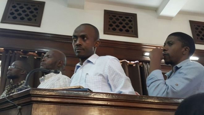 Ring leader, Isa Ahmed Luyima (centre) and others at the the trial. Photo credit: BBC