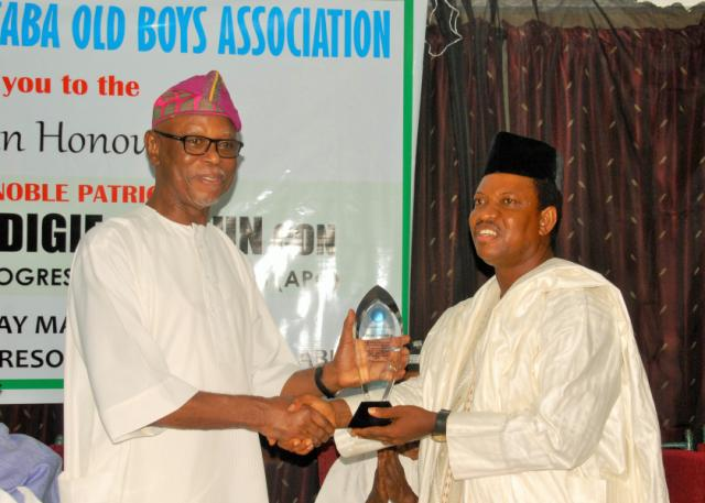 At a dinner held in his honour in Abuja on Saturday night, May 7, 2016, the National Chairman of the All Progressives Congress (APC), Chief John Odigie-Oyegun (left) receives an achievement award from the President of Saint Patrick's College (SPC), Asaba, Old Boys Association (Abuja Branch), Ogbuefi Tony Anyameluhor
