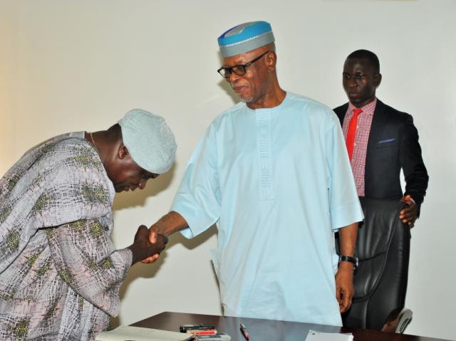 The National Chairman of the All Progressives Congress (APC), Chief John Odigie-Oyegun (right) congratulating the Chairman of the party's fact-finding/reconciliation committee for Edo state, Prince Olagunsoye Oyinlola during the committee's inauguration at the APC National Secretariat in Abuja on Monday.
