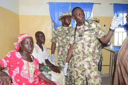 Amina Ali being attended to by military doctors