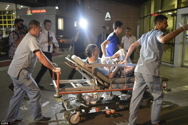 Medics carry out some of the injured at Ataturk Airport
