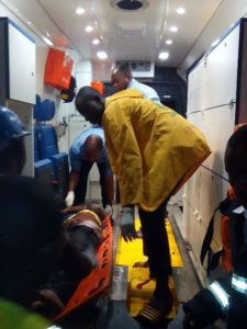 A dead victim being put in an Ambulance by LASAMBUS