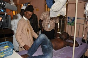 Governor El-Rufai consoling Emmanuel during the visit