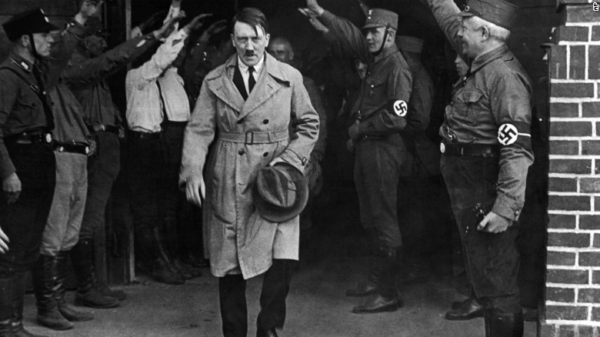 Hitler, then leader of the National Socialists, leaves the party's Munich headquarters in December 1931. Photo credit: CNN