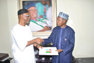 (R-L) The National Chairman of the All Progressives Congress (APC), Chief John Odigie-Oyegun receiving the report of the Party's Committee for Edo State Governorship Primary Election headed by the Katsina State Governor, Aminu Bello Masari at the Party National Secretariat in Abuja on Monday.