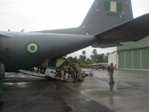 NAF technicians offloading Ground  Support Equipment    flown-in by C-130H aircraft in support of the newly  deployed fleet