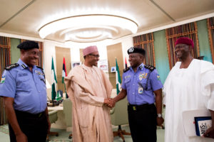 Arase, President Buhari, Idris and the President's Chief of Staff, Mallam Abba Kyari savouring the moment with the new IGP