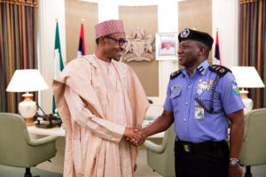 """""""You must have a firm grip of the security situation,"""" Buhari seems to be telling the new IGP with the grip handshake"""
