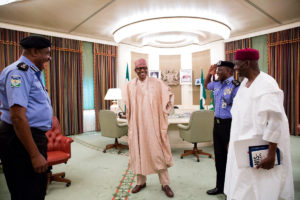 """""""Ready to fire on all cylinders sir,"""" Idris seems to assure the President, his predecessor and Mallam Kyari as he pay compliments to the President"""