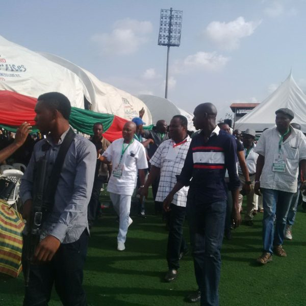 Odubu (in white) acknowledging cheers from his supporters