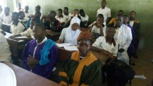 Osun students in church robes in a classroom