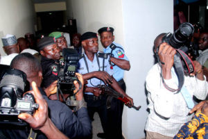 Police officers threaten to shoot journalists as they struggle to control crowd in the court premises (photo: Femi Ipaye)