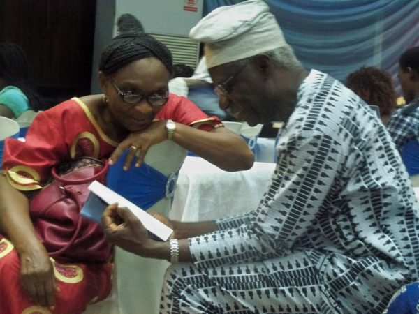 Prof. Adenike Osofisan showing her husband's book another guest