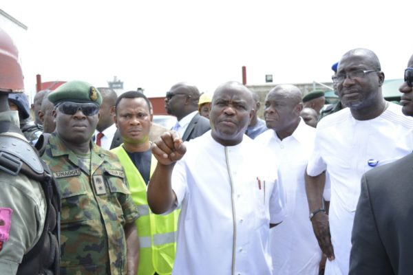 Rivers State Governor, Nyesom Ezenwo Wike (m) Rivers State PDP Chairman, Bro Felix Obuah (r) Special Adviser on Lands, Anugbum Onuoha, Caretaker Committee Chairman of Obio/Akpor, Prince Collins Onunwu and Lt Col AC Unaogu during the demolition of cultists hideout at Rumuolumini supervised by the governor on Tuesday.