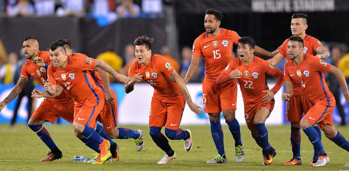 Chile players  celebrate after winning the penalty shootout