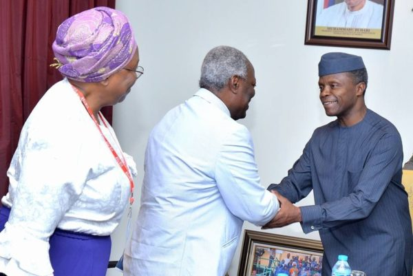 Vice President Prof. Yemi Osinbajo (SAN) in a handshake with Pastor W. Kumuyi, during a courtesy visit at the Presidential Villa.
