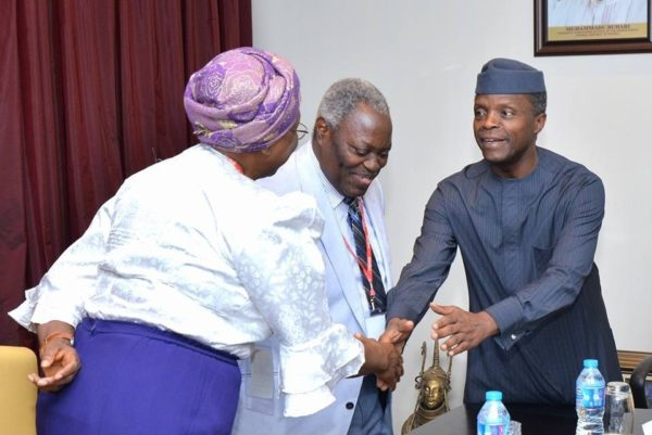 Vice President Prof. Yemi Osinbajo (SAN) in a hand shake with Pastor Mrs. E. Kumuyi, during a courtesy visit at the Presidential Villa.
