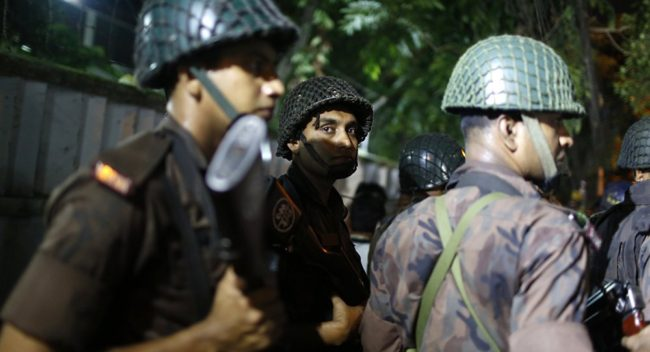 Bangladesh policemen outside the Dhaka restaurant attacked by Islamists