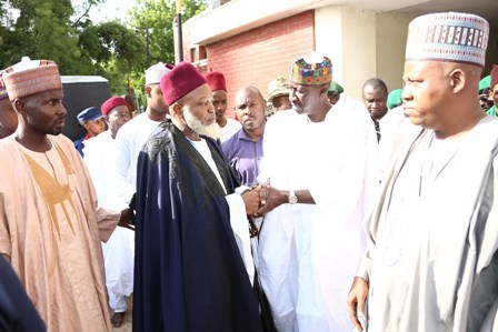 National Security Adviser to the President Major General Babagana Monguno, leading FGN delegation in a hand shake with Chief Imam of Bornu, Asil Ibn Adam AL-Sanusi and Governor of Bornu State, Alhaji Ibrahim Shettima during  the visit