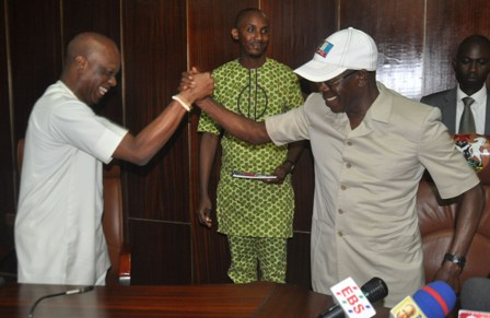 Governor Adams Oshiomhole of Edo State and his Deputy, Dr Pius Odubu hug after their reconciliation meeting at the Government House, yesterday