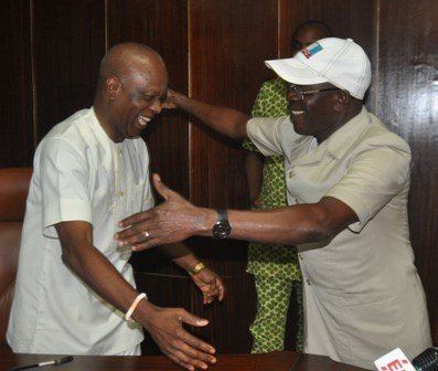 Governor Adams Oshiomhole of Edo State and his Deputy, Dr Pius Odubu hug after their reconciliation meeting at the Government House, yesterday.